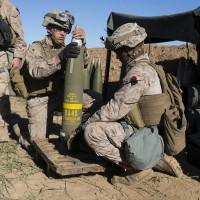 Marines preparing 155 mm round