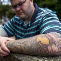 Veterans' tattoos symbolize loss, service and patriotism